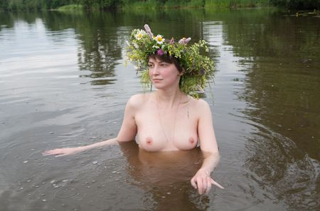 Nude girl  in  camomiles chaplet at river Stock Photo - 6632504