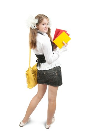 teener: schoolgirl with books and schoolbag, isolated over white Stock Photo