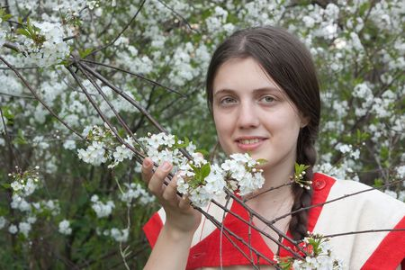 portrait of young woman in the spring garden photo