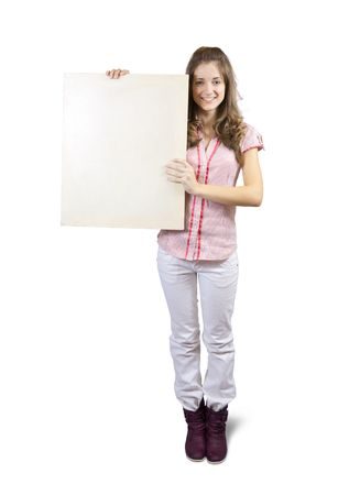 Teen girl holds blank canvas. It is isolated on a white background  photo