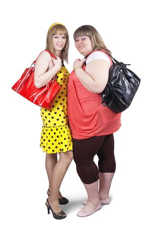 Two happy casual girls with handbags over white background