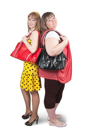 Two different girlfriends with bag over white together Banco de Imagens