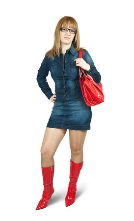 Girl in blue dress red high boots with purse. Isolated over white