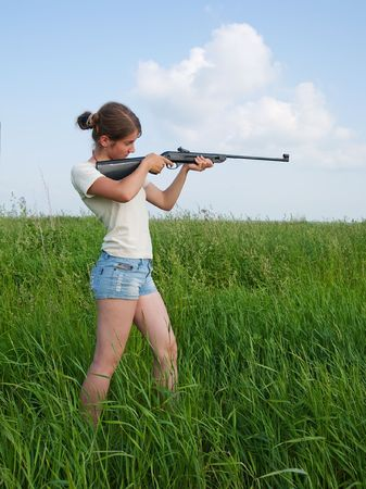 The woman aiming a pneumatic air rifle photo
