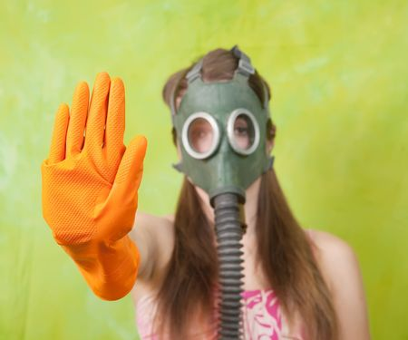 girl in gas mask pointing STOP, Focus on glove photo