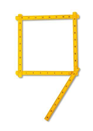 number nine: Carpenter regla mirando como n�mero nueve. Aislados sobre fondo blanco  Foto de archivo