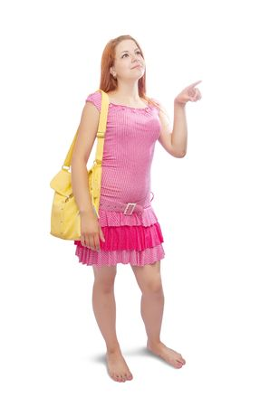 girl  with yellow handbag  pointing away, over white background Stock Photo - 6753285