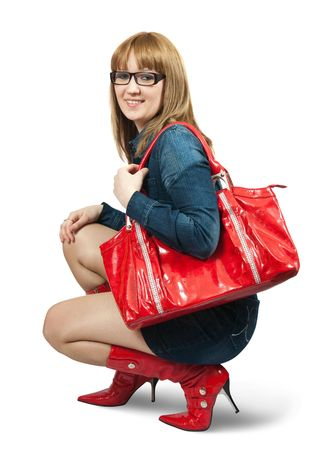 Girl in blue dress ang red high boots with purse Banco de Imagens