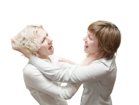 two  young woman in quarrel isolated on white  photo