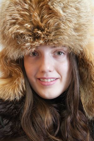 furskin: Portrait of long haired young woman in  fox hat Stock Photo