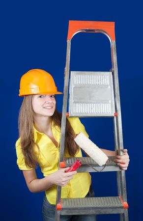 scaling ladder: female house painters with paint rollers and scaling-ladder