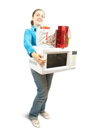 Girl in blue with microwave  and present boxes. Isolated over white photo