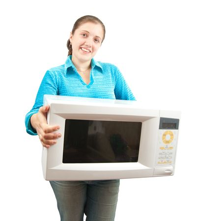 Girl in blue with microwave oven. Isolated over white photo