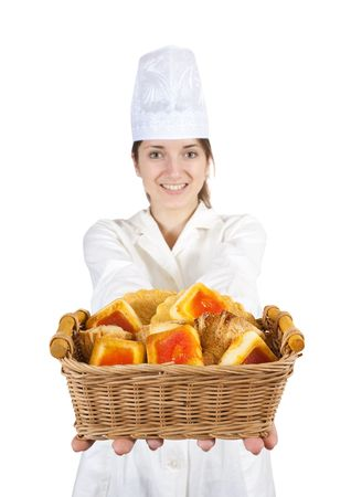 Portrait of female cook with  pastry over white photo