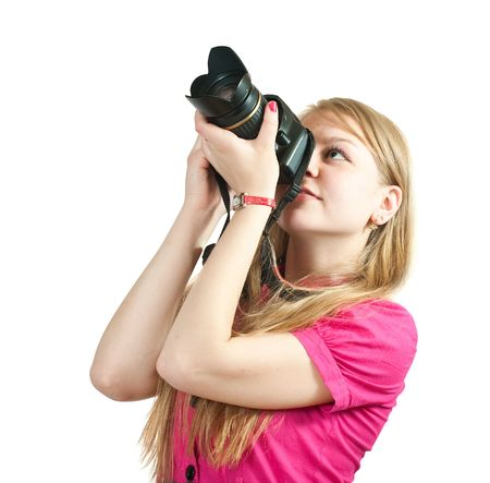 Young female photographer, isolated over white background photo