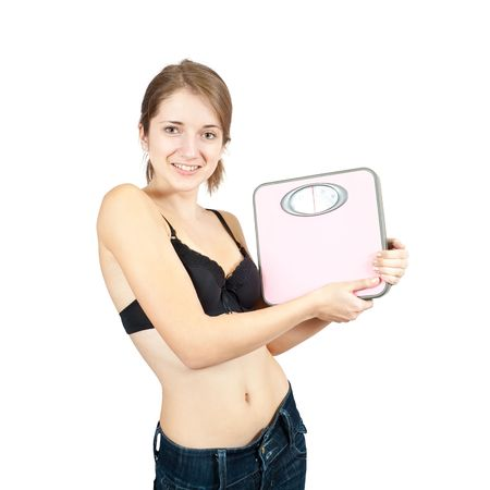 losing control: Girl holding bathroom scales. Isolated on white Stock Photo
