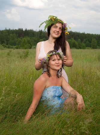 chaplet: Two  young girls in a chaplet at  meadow   Stock Photo