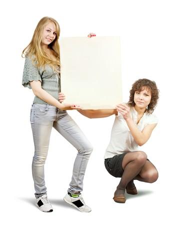 Isolated full length studio shot of two girls holding banner Stock Photo - 6861783