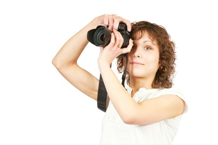 photographer girl with camera. Isolated over white background Stock Photo - 6861814