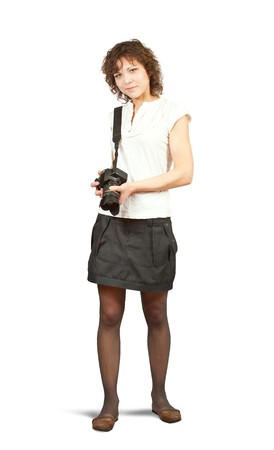 Young girl with camera. Isolated over white background Stock Photo - 6861794