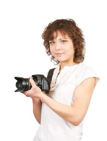 Young girl with camera. Isolated over white background Stock Photo - 6861791