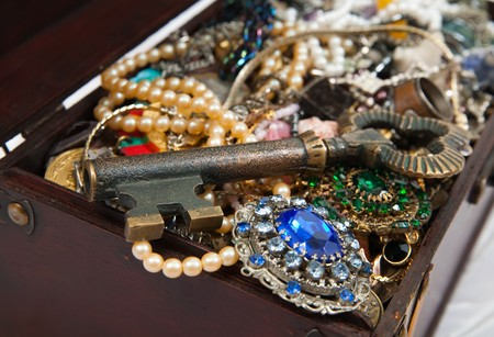 Closeup of Treasure chest with valuables and key photo