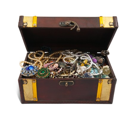 wooden treasure chest with valuables and gem, isolated  photo
