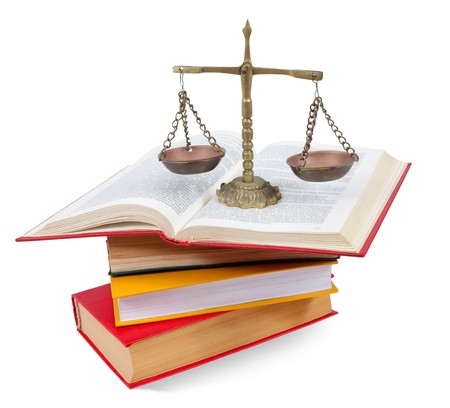 atop:  Scales of justice atop legal books