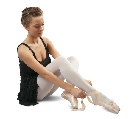 young ballerina puts on pointe. Isolated over white background Stock Photo - 6934862