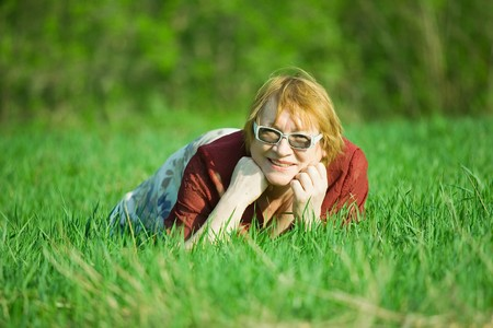 portrait of senior woman in the spring  meadow photo