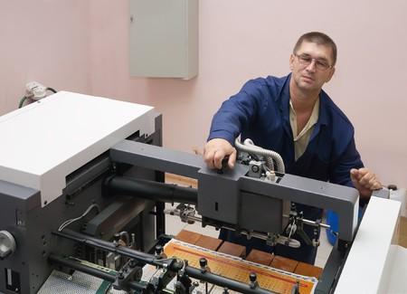 Printer working at his new offset machine Stock Photo - 6951309