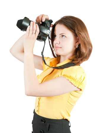 photographer girl with camera. Isolated over white background photo