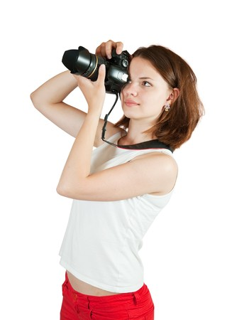 photographic: Young female photographer, isolated over white background