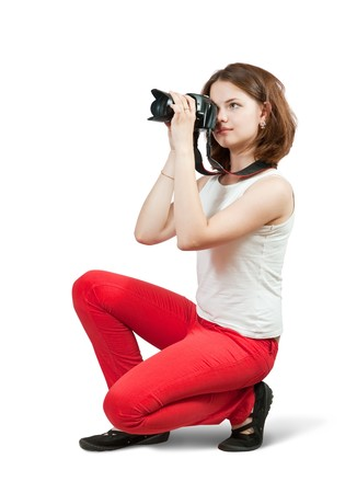 Young girl with camera. Isolated over white background