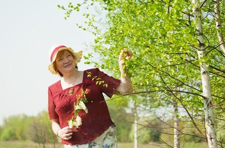 portrait of senior woman against spring  landscape Stock Photo - 6986493