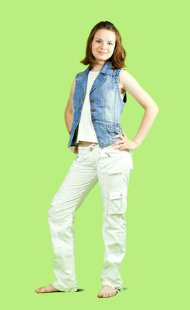 a casual teen standing confidently over green Stock Photo - 6986516