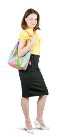 Attractive young girl with handbag standing on white background