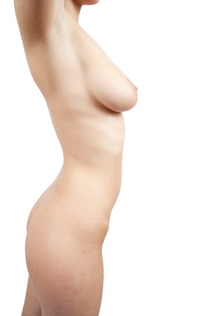 Slim female naked torso on white background  Stock Photo - 7035245