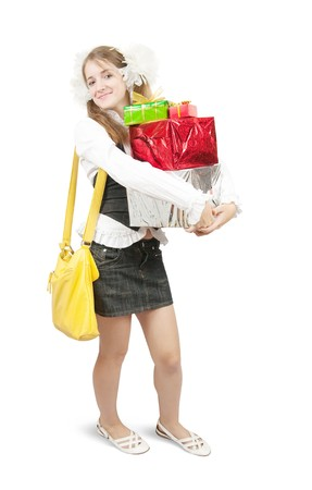 beauty schoolgirl with  gifts, isolated over white photo