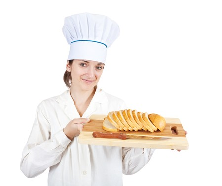 Portrait of female cook with  slice bread on cutting board over white Stock Photo - 7035328