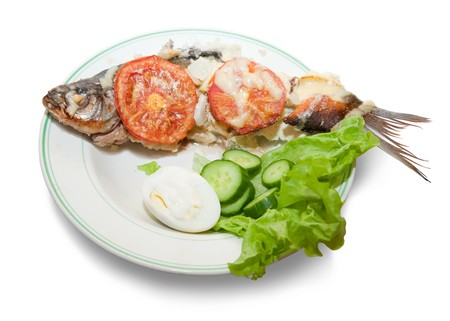 river fish: Grilled  river fish on dish. Isolated over white