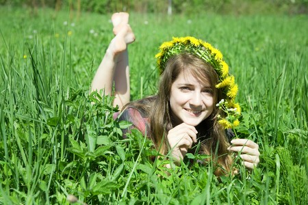 chaplet: barefoot teen girl in a chaplet lying from meadow Stock Photo