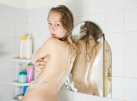 Rear view of long-haired girl in bath photo