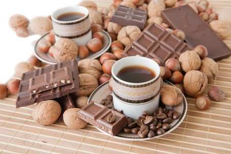 nit: cups of coffee with nuts and chocolate Stock Photo