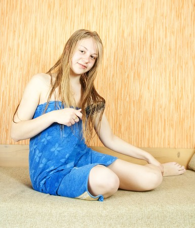 Girl combing her long hair in home inter Stock Photo - 7092205
