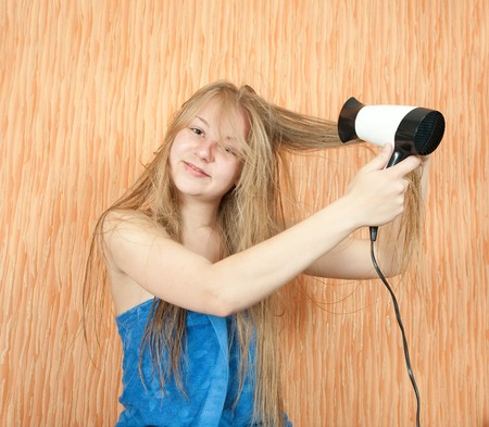 Girl dryes her long hair in home inter Stock Photo - 7092203