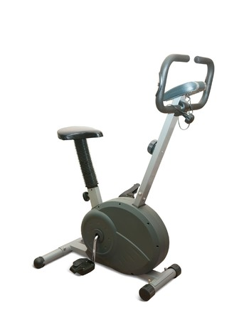 fitness equipment: Exercise gym bike isolated on white Stock Photo