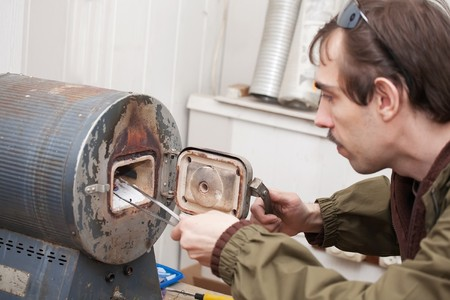 muffle: man is working with the muffle furnace Stock Photo