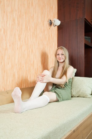 Smiling girl  relaxation in the comfortable apartment photo