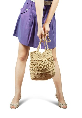 Closeup of  girl with handbag standing on white background